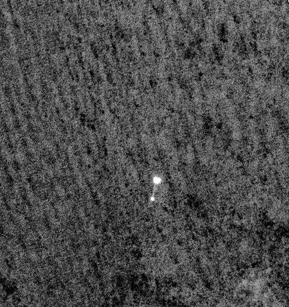 Phoenix lander under parachute